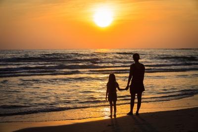 woman daughter sunset
